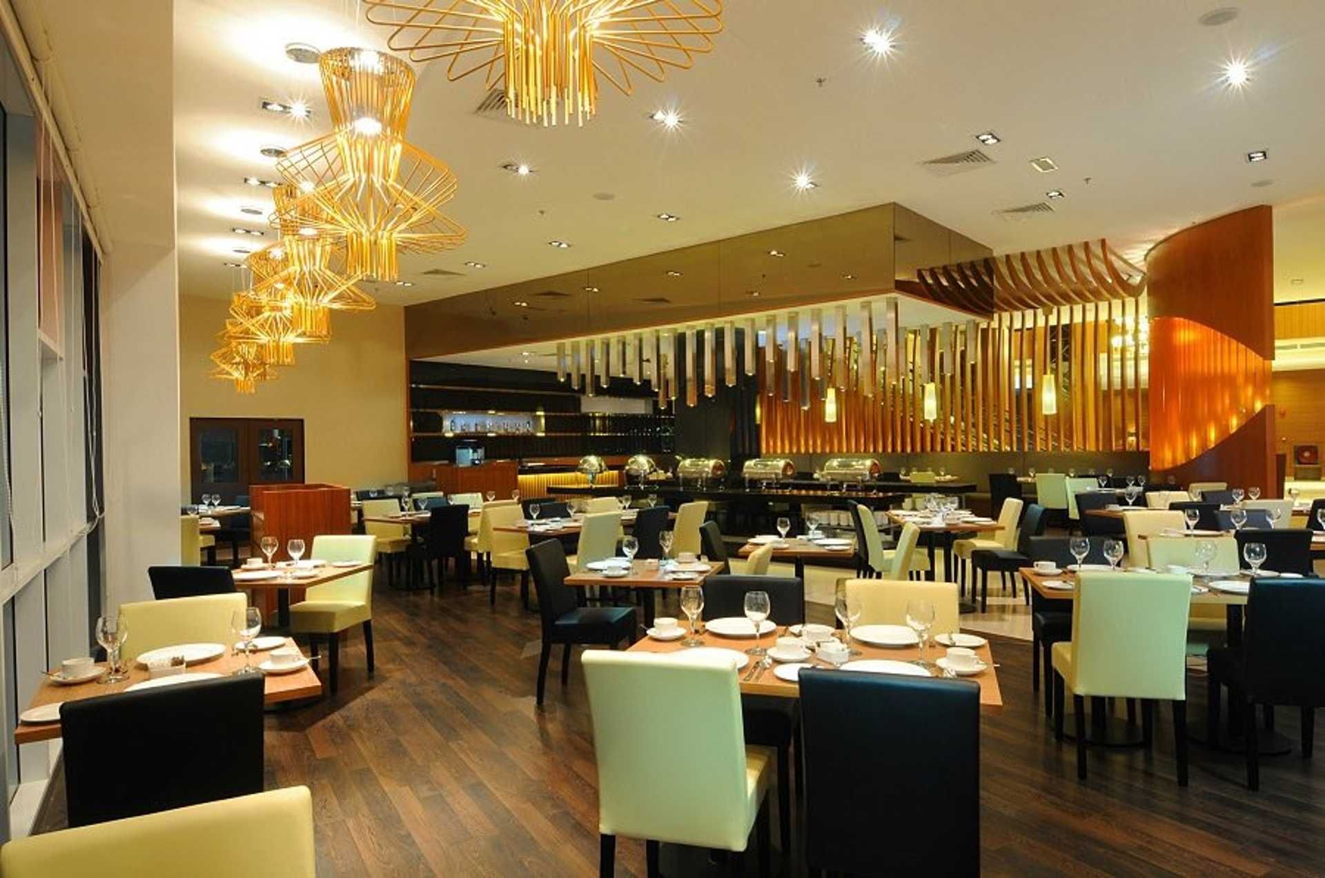 The warm and inviting interior of Olla Restaurant