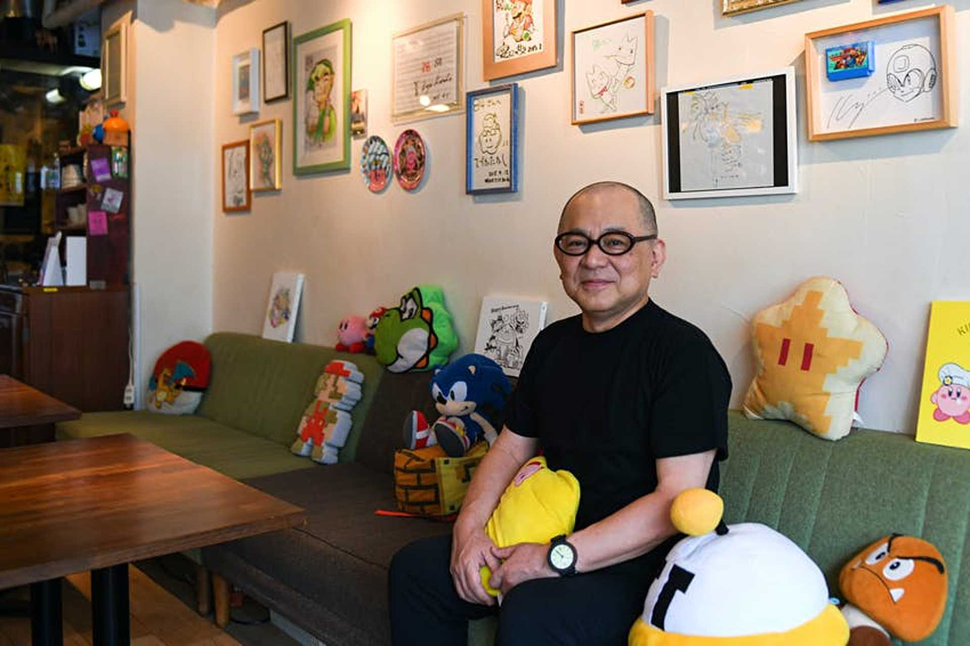 Toru Hashimoto sits inside 84, a secret café for Nintendo fans, in Tokyo, Japan, on Thursday, June 24, 2021. Tucked away at the back of a nondescript building in the hip Shibuya district, the establishment named 84 is the brainchild of a formerNintendo Co.employee Hashimoto, who initially conceived it as a sanctuary for game developers to nerd out and relax. Photographer: Noriko Hayashi/Bloomberg via Getty Images