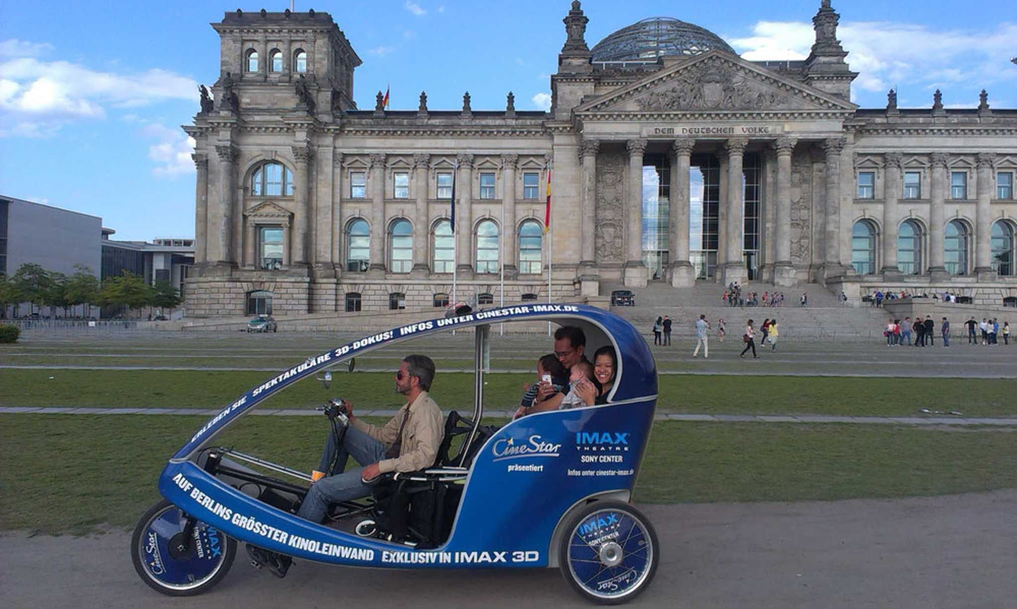Cruising past the iconic Bundestag in a BikeTaxi