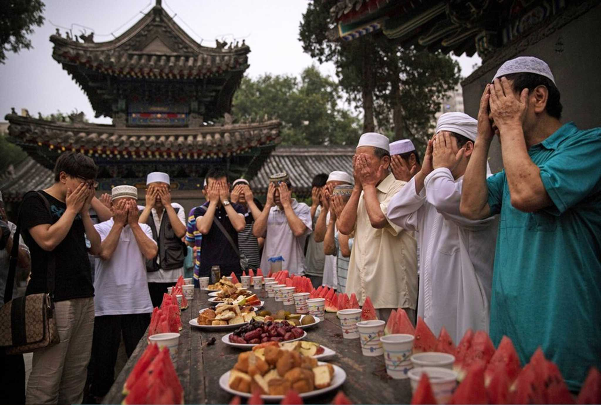 Chinese Muslims of the Hui ethnic minority pray over food before breaking their fast.
